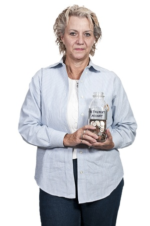 A beautiful woman holding her retirement account of coins in a milk bottle photo