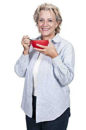 mid morning: A beautiful woman eating food from a bowl