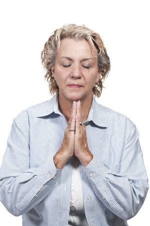 Beautiful Christian woman in a deep prayer Imagens