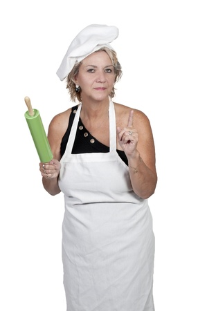 A middle aged woman chef holding a rolling pin photo