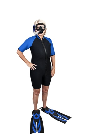 An older woman in scuba wet suit with a mask and snorkle