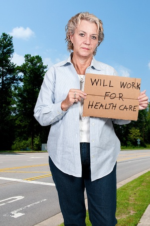 A beautiful woman holding a sign that says will work for healthcare photo