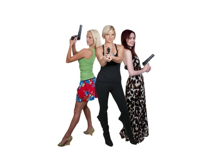 Beautiful police detectives women on the job with guns photo