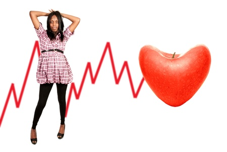 African American woman next to a heart shaped apple EKG photo