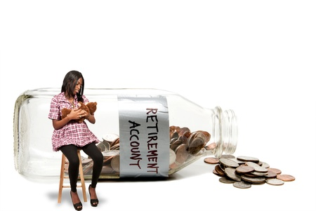 Pregnant woman with a milk bottle with coins conceptualizing a retirement account. photo