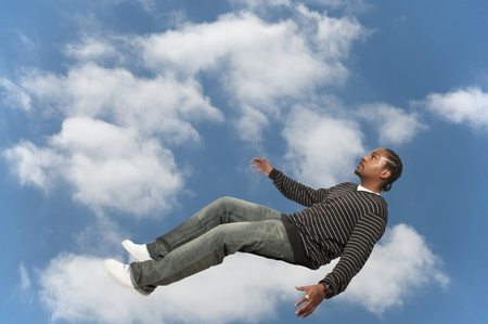 Young African American Black Man falling through the sky Stock Photo - 12550484
