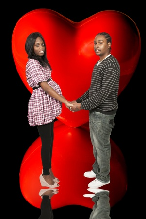 Young black African American man and pregnant woman expecting a baby