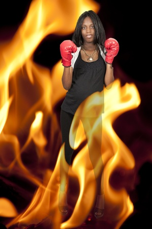 A beautiful young pregnant black woman wearing boxing gloves photo