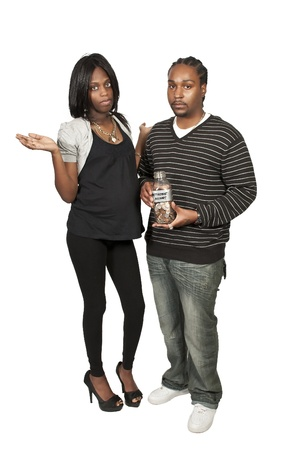 African American black couple holding a retirement account of coins in a milk bottle photo