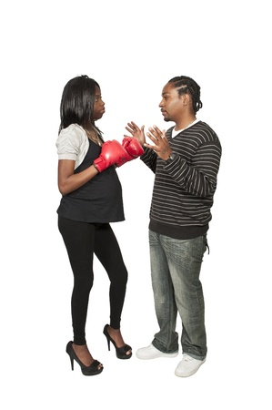 Beautiful young black pregnant woman wearing a  boxing glove and an African American man