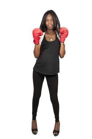Beautiful young black pregnant woman wearing a  boxing glove while motioning to come here photo