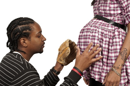 Young black African American man and pregnant woman expecting a baby photo