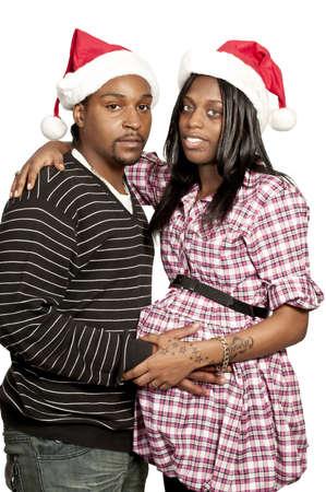 A beautiful young black couple wearing Christmas Santa Hats Stock Photo - 12550441