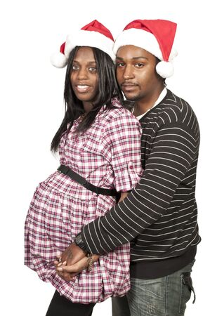 A beautiful young black couple wearing Christmas Santa Hats Stock Photo - 12550479