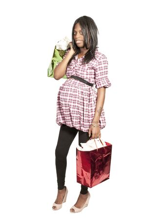 A young beautiful pregnant black African American woman on a shopping spree photo