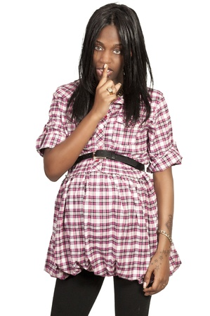 motioning: A young beautiful black African American pregnant woman motioning to be quiet