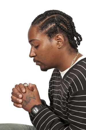man praying: Black African Americanl Christian man in deep prayer