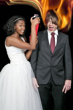 causcasian: A black African American woman extinguishing a caucasian man on fire Stock Photo