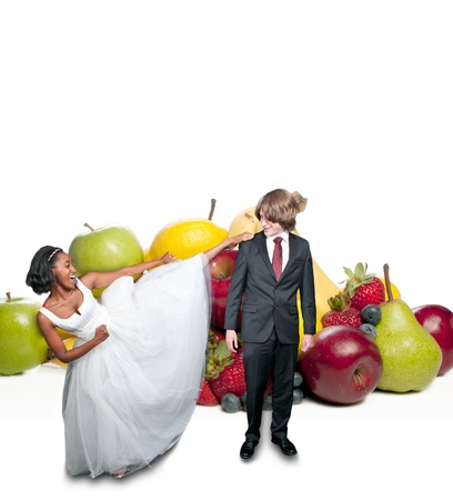 Black African American woman kicking a caucasian man in front of fruit photo