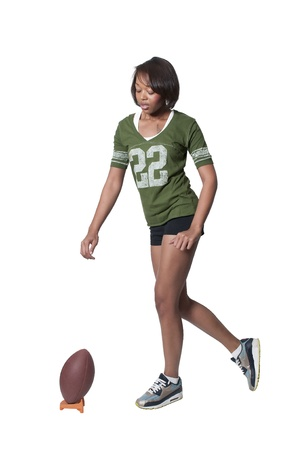 Beautiful black African American woman playing football photo