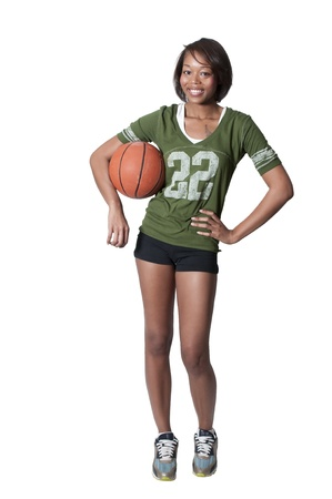Beautiful black African American woman playing a game of basketball
