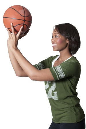 intramural: Beautiful black African American woman playing a game of basketball