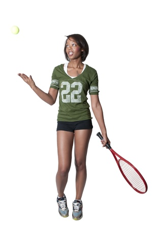 school girl sexy: A beautiful young black African American woman playing tennis