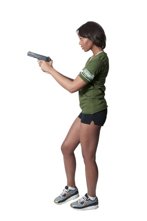 A beautiful black African American police detective woman on the job with a gun photo