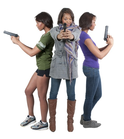 Beautiful black African American police detectives women on the job with guns photo