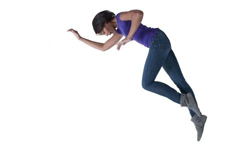 A beautiful young black African American woman falling Stock Photo