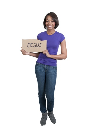 A beautiful young black woman holding up a Jesus sign Stock Photo