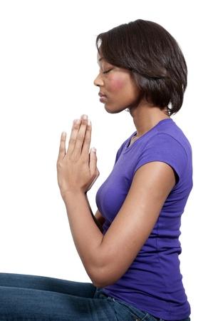 Beautiful Christian woman in deep prayer
