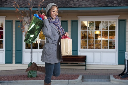 A young beautiful black African American woman on a shopping spree photo