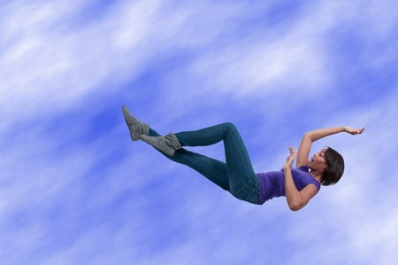 A beautiful young black African American woman falling through the sky photo
