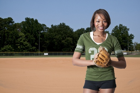 diamond plate: Black African American woman playing baseball at a community park