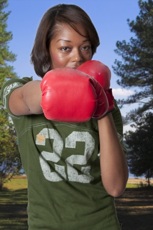 african american woman: Set of professional sports boxing gloves in action