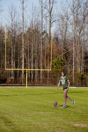 Beautiful black African American woman playing football photo