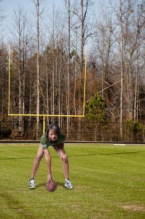 Beautiful black African American woman playing football Stock Photo - 12102260