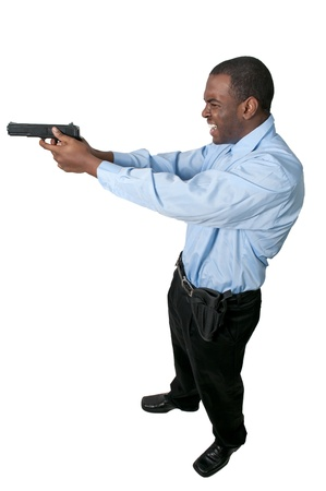 A black African American police detective man on the job with a gun photo