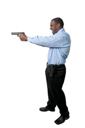 A black African American police detective man on the job with a gun Stock Photo - 12100860