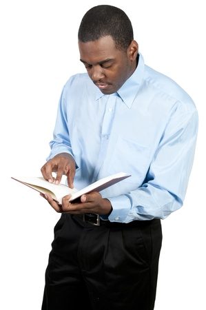 A handsome black man reading a book Stock fotó