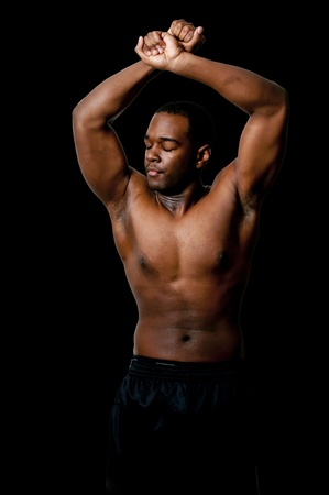 muscular body: Young African American black man with his shirt removed Stock Photo