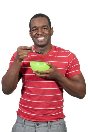 Young black African American man eating food from a bowl photo
