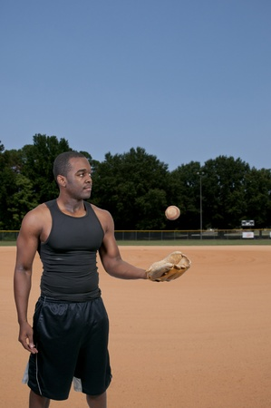 A black African American man baseball player at a game photo