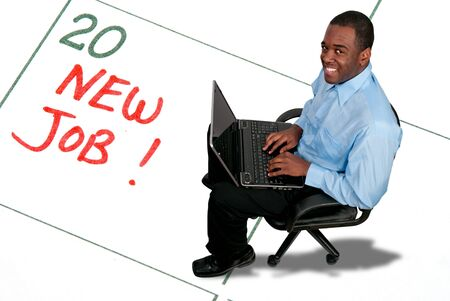 reminding: Black African American man with a computer on a calendar entry reminding of a New Job