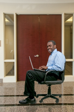 computer user: A black African American man computer user