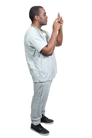 phlebotomist: A black man African American doctor holding a test tube vial sample of blood Stock Photo
