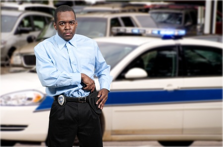 A black African American police detective man on the job with a gun Stock Photo - 12319943