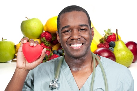 A black male African American doctor cardiologist holding a red heart photo