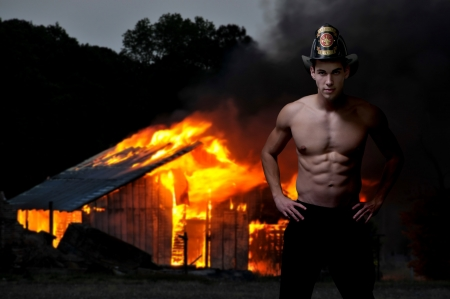 public houses: Young attractive male firefighter at a fire